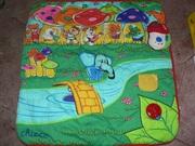 розвивающий музыкальный коврик фирмы  чико